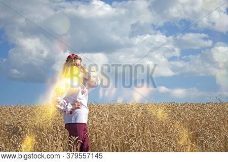 Beautiful Girl In National Ukrainian Clothes On The Wheat Field