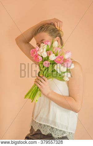 Woman With Bouquet Over Beige Background