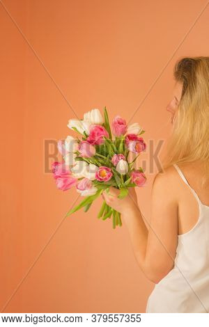 Portrait Of A Beautiful Girl In Dress Holding Tulip Bouquet