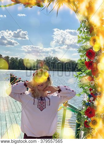 Ukrainian Young Woman Wear Traditional Ukrainian Clothes And Flower Wreath In Ethno Festival