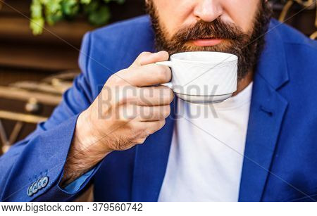 Beard Man Hold Coffee Or Coffe Cup At Cafe In The Morning. Cup Of Coffee. Cappuccino And Black Espre