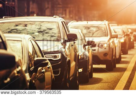 Cars Standing In A Line During Traffic Jam At Sunset