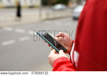 Man Stands At Crossroads With Phone In His Hands. Pedestrian Neglects Rules Road. Dangerous Section
