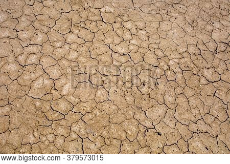 Drought, Dried Cracked Earth. Cracks In The Clay. Water Shortage Problem. The Heat Of Distress Is Hu