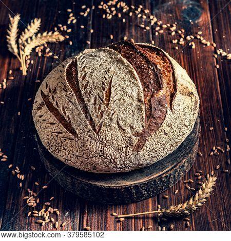 Buckwheat Sourdough Bread On A Rustic Table Board