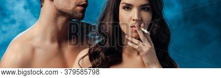 Panoramic Crop Of Naked Woman Smoking Cigarette Near Shirtless Man On Black With Smoke