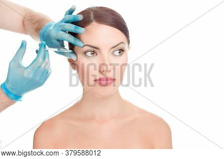 Woman Having Anti Wrinkles, Anti-aging Serum Shot Around Eyes Plastic Surgery Done By Doctor's Hand