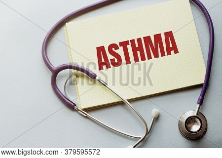 On A Purple Background A Stethoscope With Yellow List With Text Asthma