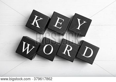 Black Cubes With Word Keyword On White Wooden Background, Flat Lay