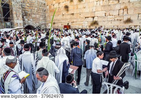 The blessing of Cohenim. Jews praying at the Western Wall. Solemn celebratory ceremony at the Western slope of the Temple Mount in the Old City of Jerusalem. The concept of religious and photo tourism