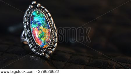 Opal Is A Silver Ring Decorated With An Opal Gem.