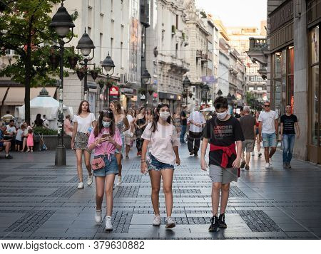 Belgrade, Serbia - July 29, 2020: Young People, Young Man And Two Young Girls, Friends, Walking Wear