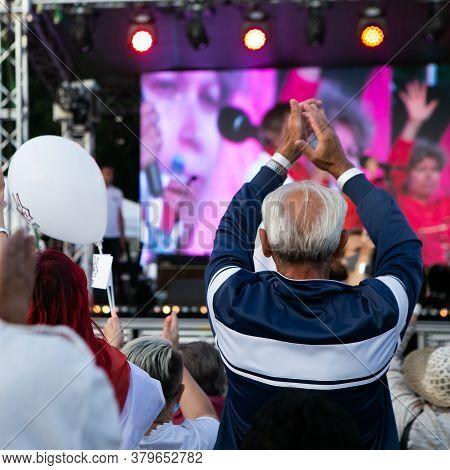 Minsk/belarus - July 30, 2020: Elderly Man Applauds At Opposition Rally In Minsk On July 30, 2020. B