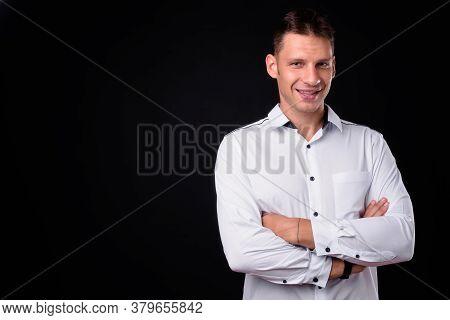 Portrait Of Happy Businessman Against Black Background