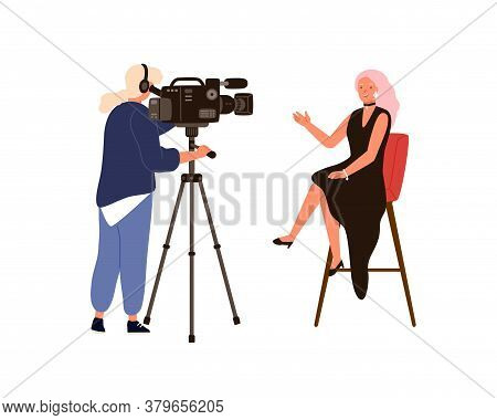 Woman Presenter Talking Sitting On Chair During Newscast Shooting. Video Operator Or Cameraman Holdi