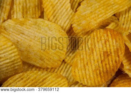 Food Background Of The Tasty Crispy Potato Chips