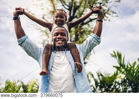 Portrait Of Enjoy Happy Love Black Family African American Father Carrying Daughter Little African G