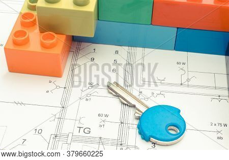 Wall Of Colorful Building Blocks And Home Keys Lying On Construction Drawing Of House. Building Hous