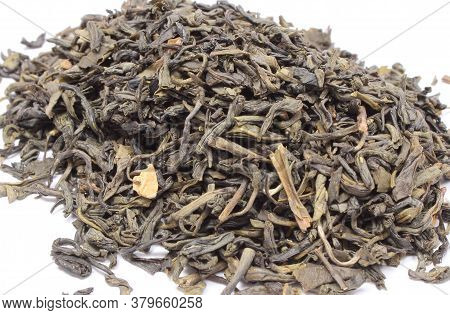 Closeup Of Dried Green Tea On White Background. Healthy Lifestyles