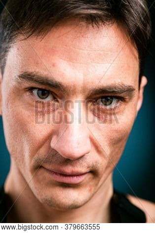 Close Up Vertical Studio Headshot Portrait Of Young Caucasian Man Stand Look At Camera Posing, Feel