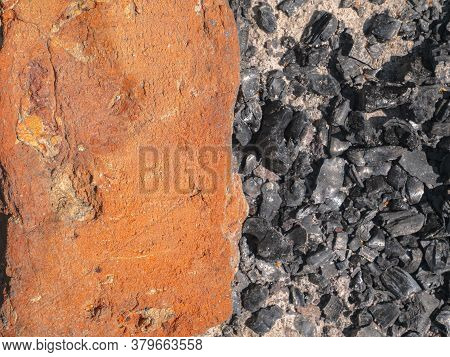 Red Brick On The Coals Of An Extinct Fire. Two Colors. Abstract Image. Place Of Fire. Place For Text
