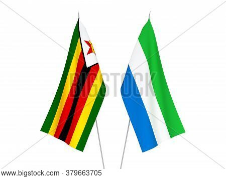 National Fabric Flags Of Sierra Leone And Zimbabwe Isolated On White Background. 3d Rendering Illust