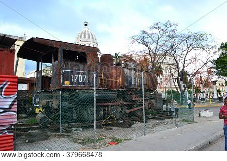 Old And Rusty Vintage Train Wagons Dating Back From The Communist Era In Havana, Cuba