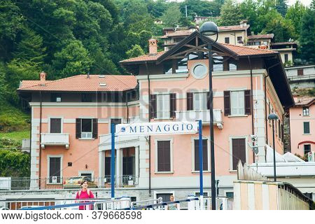Menaggio. Lake Como. Italy - July 18, 2019: Ferry Pier in the Commune of Menaggio. Lombardy. Signboard with Name of the City.