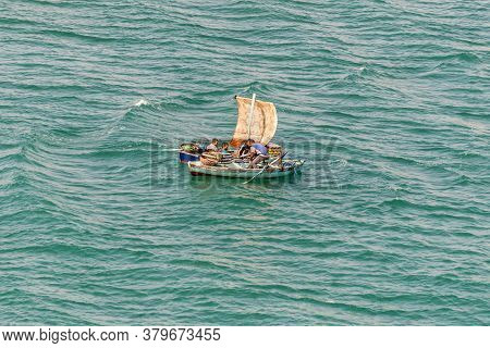 Ismailia, Egypt - November 14, 2019: Fishermen In A Wooden Boats Under A Sail Along The Suez Canal N