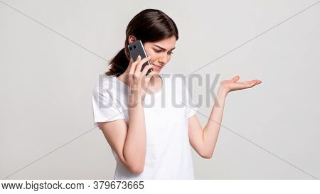Disturbed Woman Portrait. Phone Call. Shocked Skeptic Lady Shrugging Received Weird Offer Isolated O