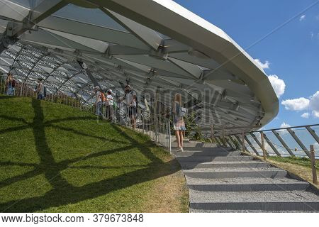People Relax In Modern Amphitheater With Glass Dome In Zaryadye Park Near Moscow Kremlin In Summer,