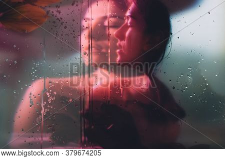 Nature Portrait. Pure Soul. Sensual Woman Face Blur Silhouette In Neon Red Bokeh Light Behind Steame