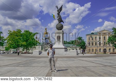 Kharkiv, Ukraine - July 20, 2020: A Male Tourist Wearing A Medical Protective Face Mask Poses On Con
