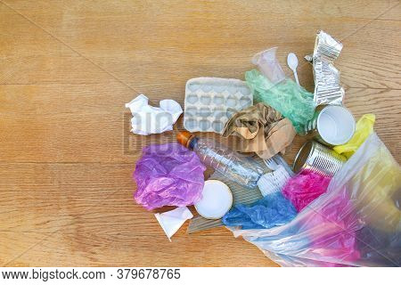 Garbage Bag With Different Trash On Wooden Background. Flat Lay.