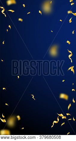 Streamers And Confetti. Gold Streamers Tinsel And Foil Ribbons. Confetti Vignette On Dark Blue Backg