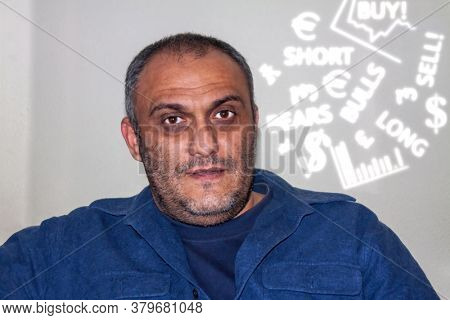Unshaved Man is his forties in casual clothing smiling facing the camera