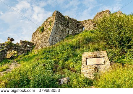 Khust City, Western Ukraine - July 29, 2020: Ruins Of Old Hungarian Castle At Sunset.