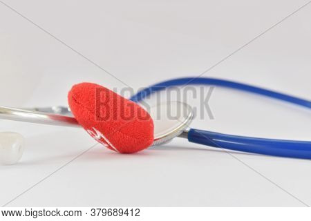 Blue Stethoscope Medical And Red Heart On White Background. Idea For Doctor Diagnostic Disease.