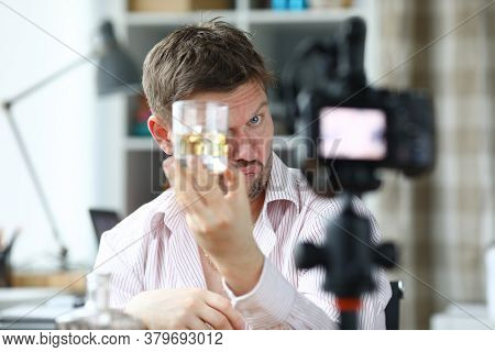 Drunk Man Eating An Alcoholic Drink In Front Of The Camera. Guy Drinks At Home During Quarantine. A