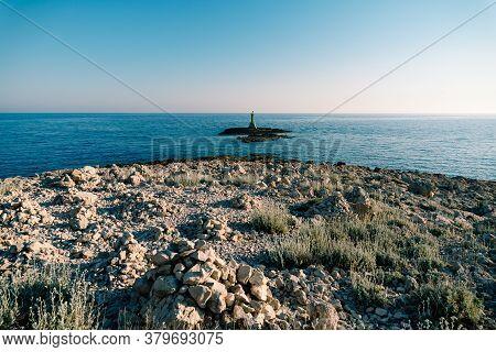 A Large Metal Green Lighthouse On A Rock In The Sea, Near Cape Punta Planka In Croatia.