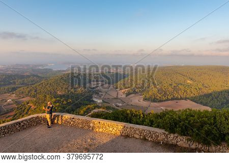 Es Mercadal, Menorca - October 13, 2019: Tourists Take A Picture Against The Backdrop Of The Beautif