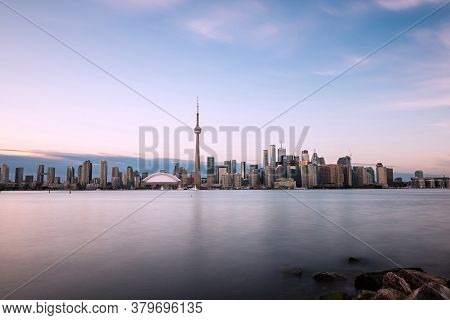 Toronto Skyline With Lake Ontario In The Foreground, As Seen From Center Island. Long Exposure.