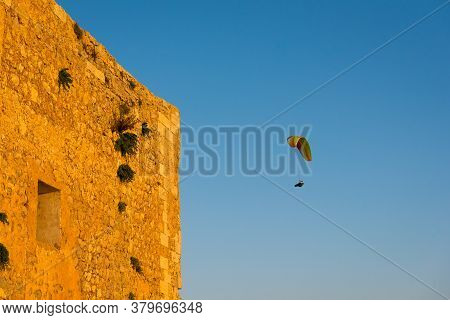 Flying Paraglider Over Menorca Island. Baleares, Spain