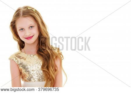 Cheerful Little Girl Sitting On A White Banner On Which To Write The Inscription. The Concept Of Adv