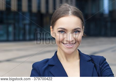Close Up Beauty Portrait Of Young Professional Woman In Business Suit Showing Toothy Smile At The Ca