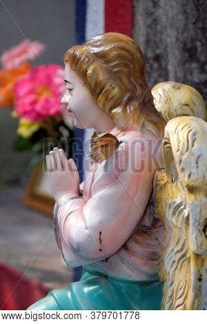 KUMROKHALI, INDIA - FEBRUARY 28, 2020: Angel at the Tomb of the Croatian Jesuit Missionary Ante Gabric Behind the Catholic Church in Kumrokhali, West Bengal, India