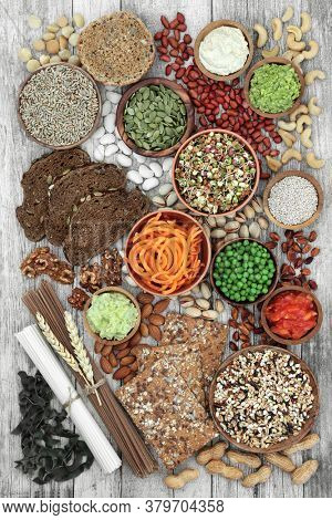 Low glycemic health food selection for diabetics high in antioxidants, anthocyanins, protein, smart carbs & omega 3 fatty acids. Below 55 on the GI index. Top view on rustic wood.