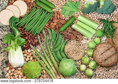 Vegan food for healthy diet  with foods high in protein, vitamins, minerals, antioxidants, omega 3, smart carbs and dietary fibre. Mindful eating concept. Flat lay.