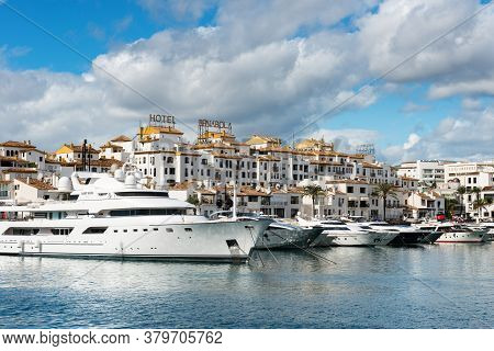 Marbella, Spain - October 13, 2016: White Expensive Luxury Yachts Moored In The Marina Of Puerto Jos