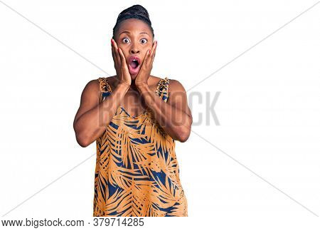 Young african american woman wearing casual clothes afraid and shocked, surprise and amazed expression with hands on face